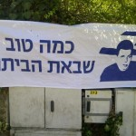"These posters were hung all over Jerusalem says ""How good is the coming home."""