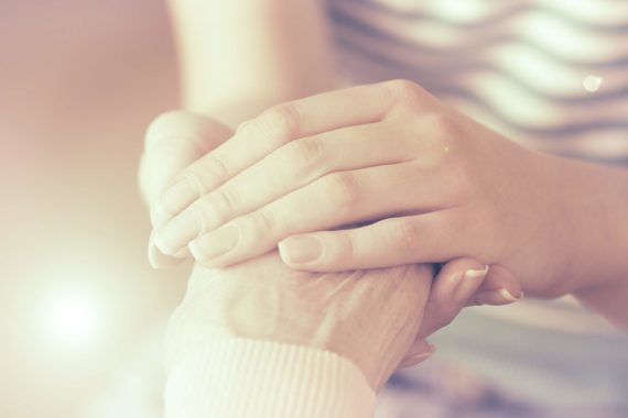 bigstock-Helping-hands-care-for-the-el-OP