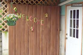 "It doesn't look exactly like that, but our door does say ""Welcome"" on it."